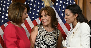 House Speaker Nancy Pelosi of Calif., left, talks with Rep. Alexandria Ocasio-Cortez, D-N.Y., right, and her mother Blanca Ocasio-Cortez, center, during a ceremonial swearing-in.