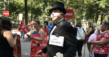 "Someone dressed as ""Uncle Pennybags"" from the board game Monopoly marched with the Hahnemann University Hospital employees."
