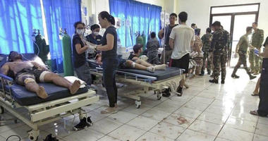 Bomb victims receive treatment in a hospital after two bombs exploded outside a Roman Catholic cathedral in Jolo, the capital of Sulu province in southern Philippines where militants are active Sunday, Jan. 27, 2019.