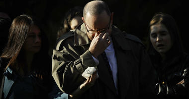 A mourner reacts outside Rodef Shalom Congregation before the funeral services for brothers Cecil and David Rosenthal, Tuesday, Oct. 30, 2018, in Pittsburgh.