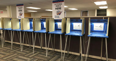 In this Sept. 20, 2018 photo, voting booths stand ready in downtown Minneapolis for the opening of early voting in Minnesota.