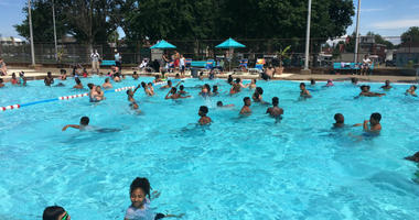 Neighborhood youngsters swim and play in the Lawncrest Pool.