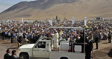In this Jan. 18, 2018, file photo, Pope Francis arrives to celebrate Mass on Lobito Beach in Iquique, Chile.