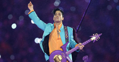 In this Feb. 4, 2007, file photo, Prince performs during the halftime show at the Super Bowl XLI football game at Dolphin Stadium in Miami.