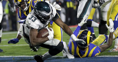 Philadelphia Eagles running back Josh Adams scores past Los Angeles Rams free safety Lamarcus Joyner during the first half in an NFL football game Sunday, Dec. 16, 2018, in Los Angeles.