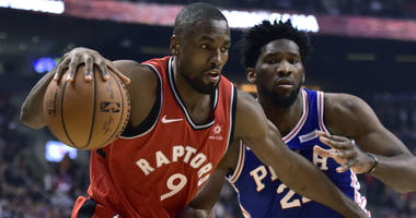 Toronto Raptors forward Pascal Siakam (43) and Philadelphia 76ers guard JJ Redick (17) battle for a loose ball during the second half of an NBA basketball game, Wednesday, Dec. 5, 2018 in Toronto.