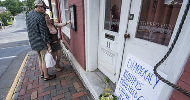 Passersby examine the menu at the Red Hen Restaurant Saturday, June 23, 2018, in Lexington, Va.