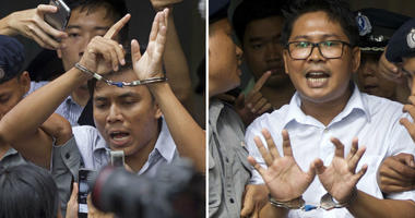 Reuters journalists Kyaw Soe Oo, left, and Wa Lone, are handcuffed as they are escorted by police out of the court Monday, Sept. 3, 2018, in Yangon, Myanmar.