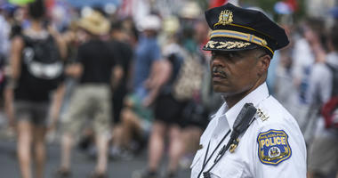 Philadelphia police commissioner Richard Ross Jr. kept an eye as Bernie Sanders supporters march down Broad Street during the Democratic National Convention.