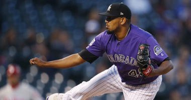 Colorado Rockies starting pitcher German Marquez works against the Philadelphia Phillies in the first inning of a baseball game Wednesday, Sept. 26, 2018, in Denver.