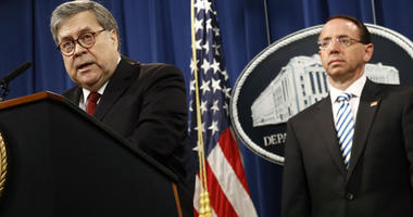 Attorney General William Barr speaks alongside Deputy Attorney General Rod Rosenstein about the release of a redacted version of special counsel Robert Mueller's report during a news conference, Thursday, April 18, 2019.