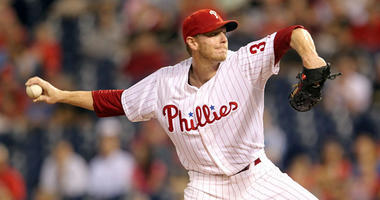 Philadelphia Phillies pitcher Roy Halladay throws in the first inning against the San Diego Padres at Citizens Bank Park in Philadelphia, Pennsylvania, on Thursday, September 12, 2013.