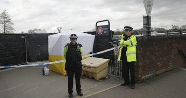 In this March 13, 2018, file photo, police officers guard a cordon around a police tent near the spot where former Russian spy Sergei Skripal and his daughter were found critically ill following exposure to the Russian-developed nerve agent Novichok.