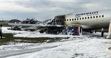 The Sukhoi SSJ100 aircraft of Aeroflot airlines is covered in fire retardant foam after an emergency landing in Sheremetyevo airport in Moscow, Russia, Sunday, May 5, 2019.