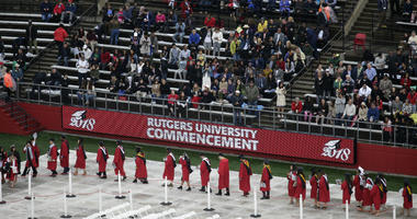 In this May 13, 2018, file photo, new graduates walk into the High Point Solutions Stadium before the start of the Rutgers University graduation ceremony in Piscataway Township, N.J.
