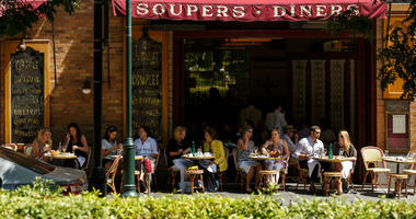 People sitting outdoors at a restaurant in Philadelphia.