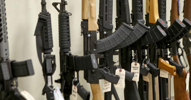 This March 1, 2018 file photo shows a display of various models of semi-automatic rifles at a store in Pennsylvania.