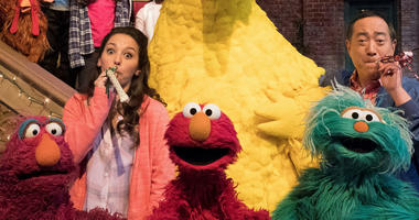 """This image released by HBO shows the cast of the popular children's show """"Sesame Street."""" Big Bird, Elmo and stars of """"Sesame Street"""" are leaving their quiet neighborhood and hitting the road."""