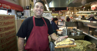 In this 2007 file photo, Rick Olivieri holds a Philly steak sandwich invented by his grandfather Pat and Pat's brother Harry.