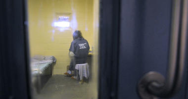 An inmate sits in the B wing for the mentally ill at the Sanislaus County Public Safety Center in Modesto, California, on Nov. 18, 2010.