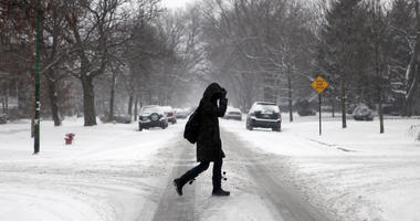 A woman walks in Chicago, Illinois