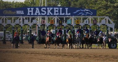 Horses break from the starting gate in the Haskell horse race at Monmouth Park in Oceanport, New Jersey.
