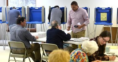 AJ Conklin takes his ballot to vote at the Oakwood Presbyterian Church precinct in State College, Pa., on Tuesday, April 26, 2016.