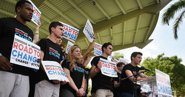 Marjory Stoneman Douglas student Cameron Kasky, far right, announces in Parkland, Fla. that this summer the students of March For Our Lives are making stops across America to get young people educated, registered and motivated to vote.