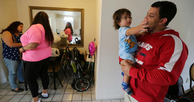 Left to right, Liza Hernandez, Christine Gonzalez, Kahil Olmeda Gonzalez and dad David Olmeda, at the Super 8 motel in Kissimmee, Fla., on May 25, 2018. They are staying in motels after evacuating the island in the wake of hurricane Maria.