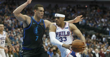 Philadelphia 76ers forward Tobias Harris (33) drives against Dallas Mavericks forward Dwight Powell (7) during the first half of an NBA basketball game in Dallas, Monday, April 1, 2019.