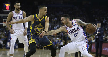 Philadelphia 76ers' JJ Redick, right, works with the ball against Golden State Warriors' Stephen Curry (30) during the first half of an NBA basketball game Thursday, Jan. 31, 2019, in Oakland, Calif.