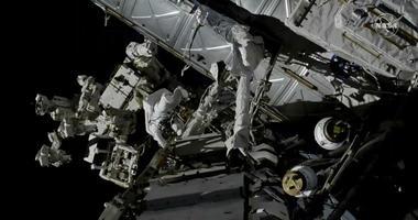 Canadian astronaut David Saint-Jacques, center left, works outside the International Space Station, Monday, April 8, 2019.