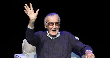 "In this Aug. 22, 2017 file photo, comic book writer Stan Lee waves to the audience after being introduced onstage at the ""Extraordinary: Stan Lee"" tribute event at the Saban Theatre in Beverly Hills, Calif."