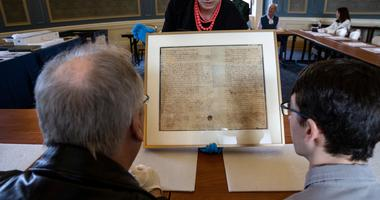 Inventors marvel at Benjamin Franklin's will at the Franklin Institute.