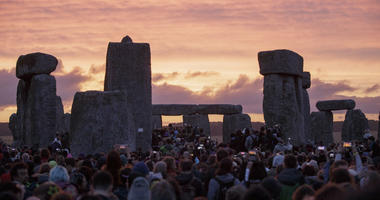 In this Sunday, June 21, 2015 file photo, the sun rises as thousands of revellers gather at the ancient stone circle Stonehenge to celebrate the Summer Solstice, near Salisbury, England.