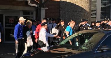 Paul Sulock, in a light-blue T-shirt, leaves Temple University Hospital.