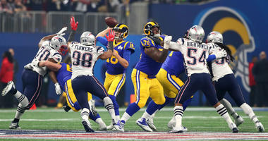 Los Angeles Rams quarterback Jared Goff (16) throws a pass against the New England Patriots in the third quarter in Super Bowl LIII at Mercedes-Benz Stadium.