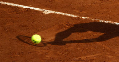 In this May 28, 2016 file photo, a player's shadow is pictured as he returns the ball during the French Open tennis tournament at the Roland Garros stadium, in Paris.