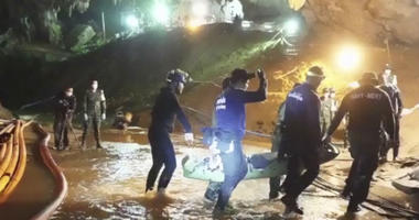 Rescuers are shown holding an evacuated boy inside the Tham Luang Nang Non cave in Mae Sai, Chiang Rai province, in northern Thailand.