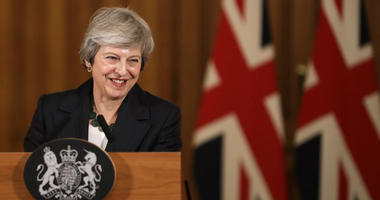 Britain's Prime Minister Theresa May smiles during a press conference inside 10 Downing Street in London, Thursday, Nov. 15, 2018.