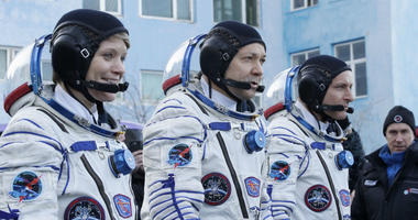 U.S. astronaut Anne McClain, left, Russian cosmonaut Оleg Kononenko, centre, and CSA astronaut David Saint Jacques, members of the main crew of the expedition to the International Space Station