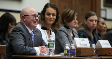 Navy Lt. Cmdr. Blake Dremann, together with other transgender military members, testify about their military service before a House Armed Services Subcommittee on Military Personnel hearing on Capitol Hill in Washington, Wednesday, Feb. 27, 2019.