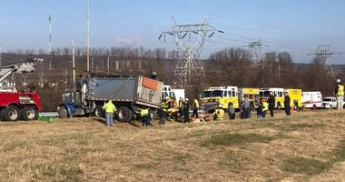 Two people are dead and at least three are hurt after a dump truck flipped onto an SUV on the ramp from southbound Route 202 to the westbound Route 30 bypass in Chester County.