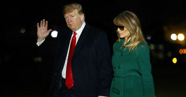 President Donald Trump and first lady Melania Trump arrive on the South Lawn of the White House after making a surprise visit to troops in Iraq, Thursday, Dec. 27, 2018, in Washington.