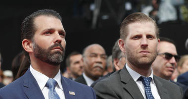 Donald Trump Jr., left, and Eric Trump attend a ceremony to mark the 75th anniversary of D-Day at the Normandy American Cemetery in Colleville-sur-Mer, Normandy, France, Thursday, June 6, 2019.