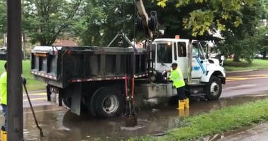 Water Department crews unclogging the drains on Kelly Drive, which is closed between Midvale and Ferry Rd.