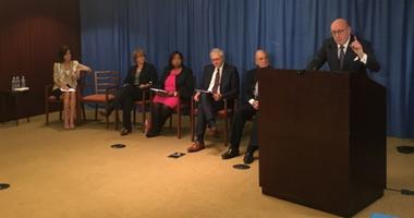 Former U.S. Sen. George Mitchell (right) discusses parameters of the Independent Reconciliation and Reparations Program (IRRP).