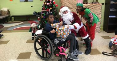 Philadelphia police officers hosted a big party Friday for all of the special needs students at Widener Memorial School, complete with pizza, Santa Claus and presents.