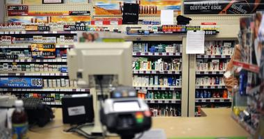 A view of cigarettes and other tobacco products on sale behind the counter at a CVS/Pharmacy store.