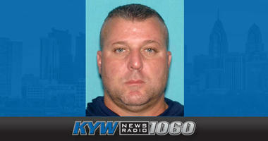 A New Jersey state trooper is under arrest, charged with a sexually explicit e-mail exchange with a woman that allegedly included a lewd photo of an underage girl.